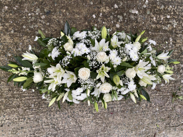 Funeral flowers Tramore Waterford coffin florist tramore cerise flowers (2)