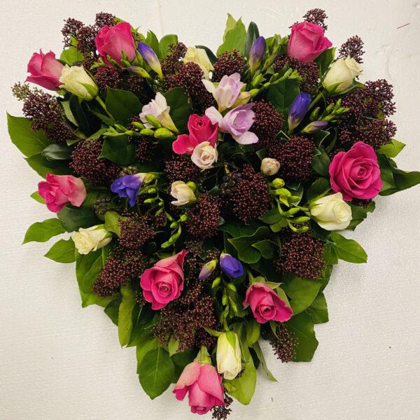 Funeral flowers Tramore Waterford heart florist tramore cerise flowers (6)