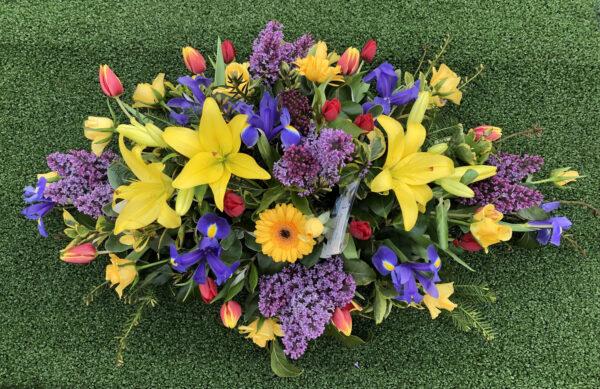 Funeral flowers Tramore Waterford spray florist tramore cerise flowers (1)