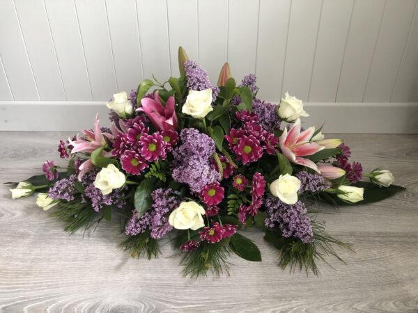 Funeral flowers Tramore Waterford spray florist tramore cerise flowers (2)